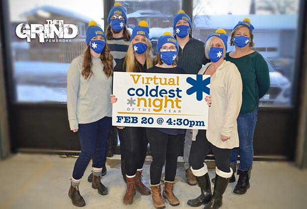 Seven people wearing winter hats holding sign that says 'Virtual Coldest Night of the Year'