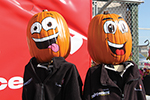 Two pumpkin people with painted on happy faces