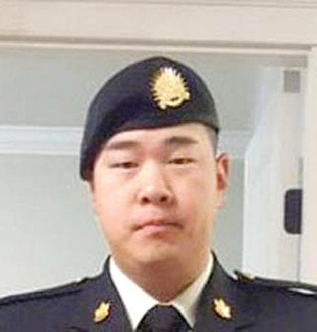 Photo of Cpl James Choi in uniform from the shoulders up